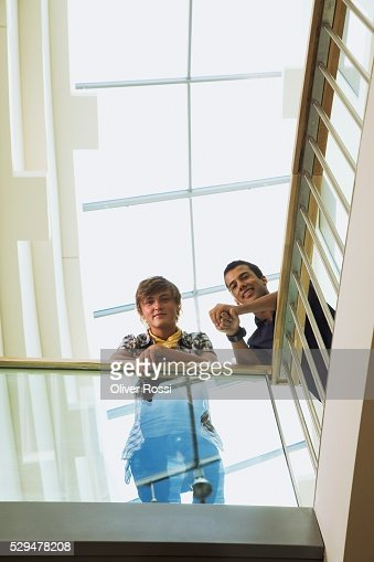Teen boys leaning on railing : Foto stock