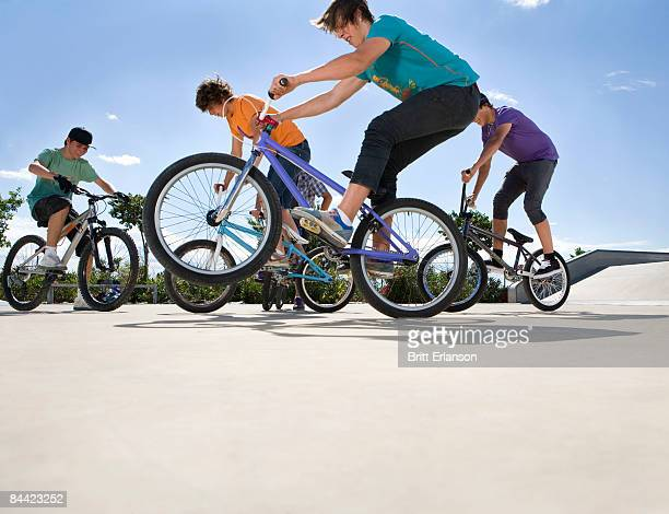 Teen boys riding bikes