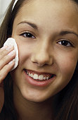 Teen cleaning face