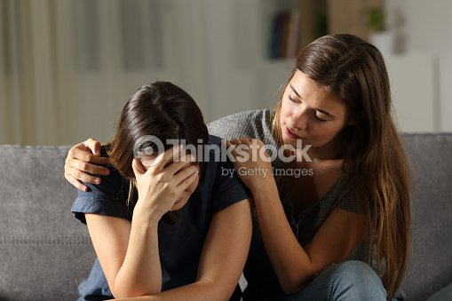 Teen comforting hes sad friend in the night : Stock Photo