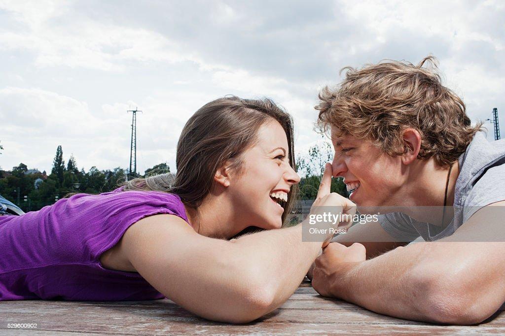 Teen (16-17) couple face to face : Stock Photo