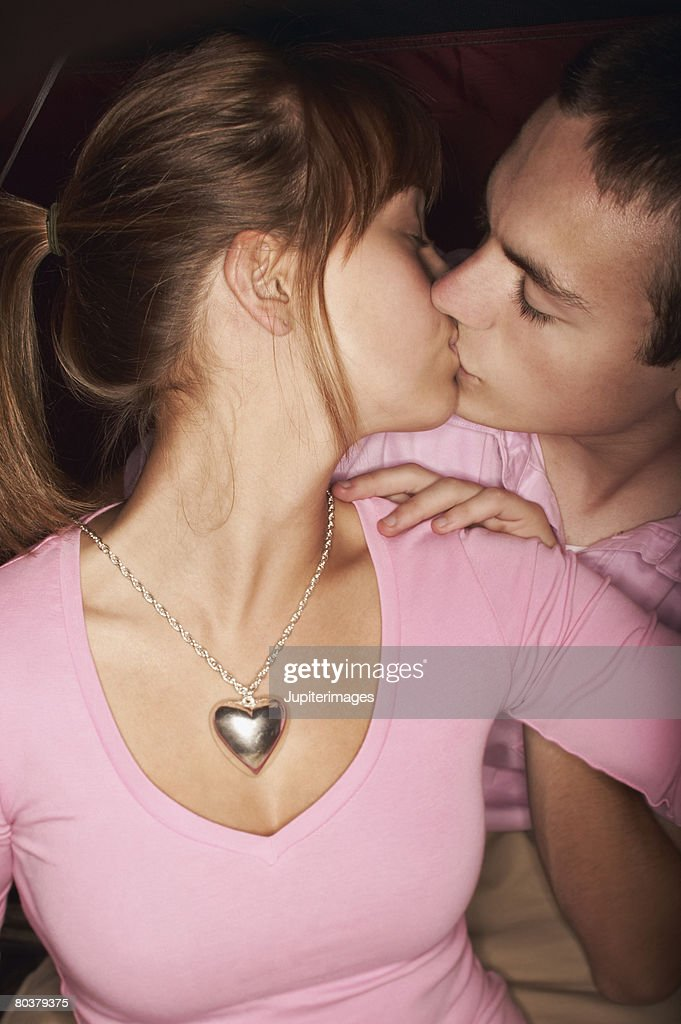 Teen couple kissing : Stock Photo