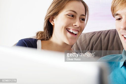 Teen (16-17) couple laughing : Stock Photo