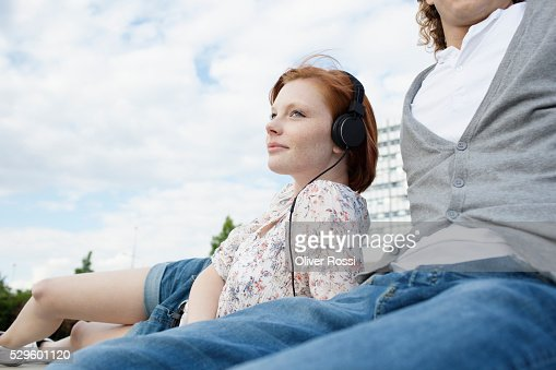 Teen (16-17) couple listening to music : Stock Photo