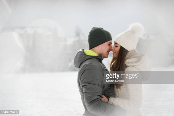 Teen couple sharing a romantic moment outdoors