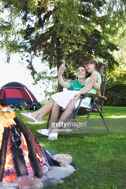 Teen couple taking picture with camera phone