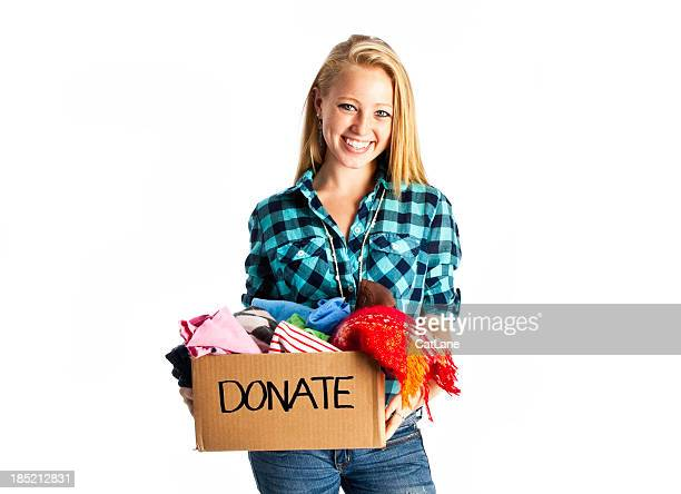 Teen Donating Clothing to Charity