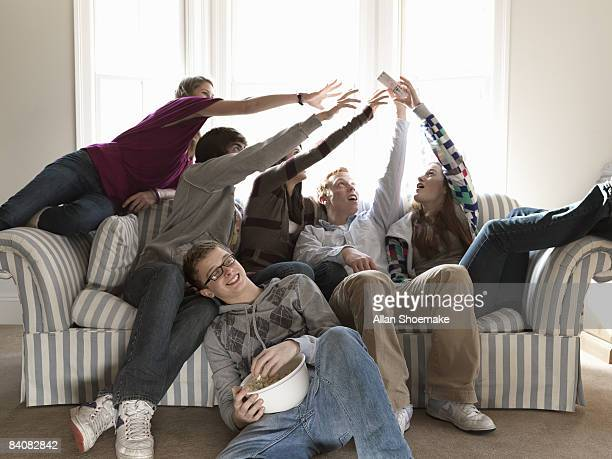 Teen Friends Fighting for Remote