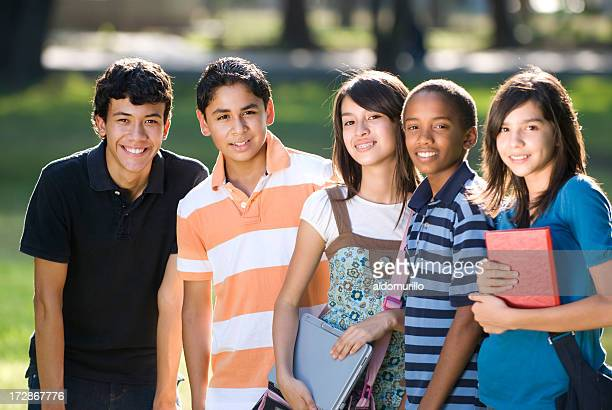 Teen friends preparing to study, facing camera