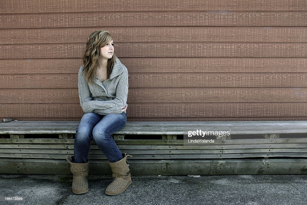Teen Girl Alone on Bench : Stock Photo