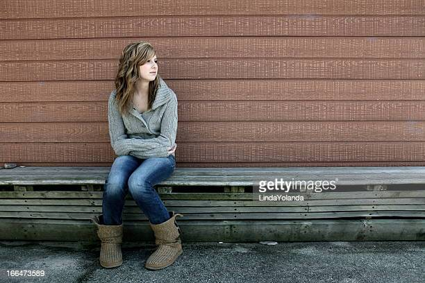 Teen Girl Alone on Bench