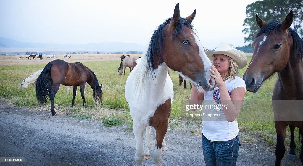 teen girl and horse out in a pasture : Stock Photo