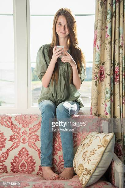 Teen girl at home with phone