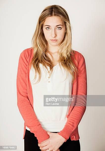 Teen girl clasping hands, portrait