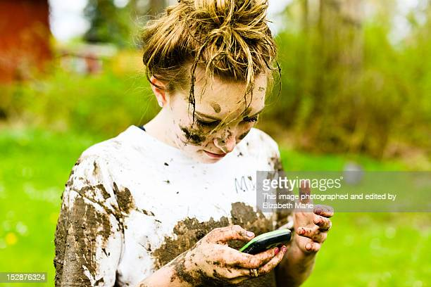 Teen girl covered in mud