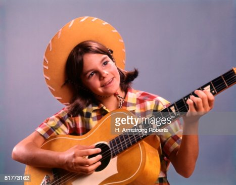 Teen Girl Cowboy Hat Playing Guitar Country Western. : Stock Photo