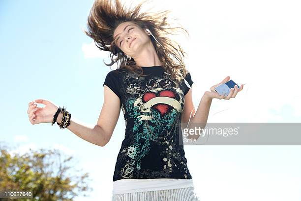 Teen girl dancing while listening to headphones