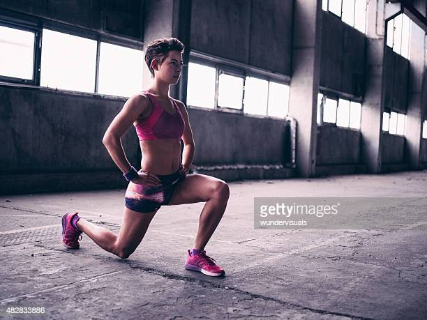 Teen girl doing a lunge warm up exercise
