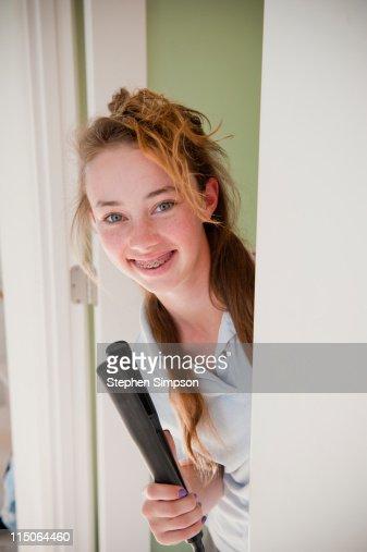 teen girl doing her hair in the morning