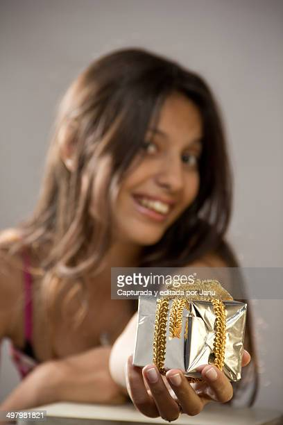 Teen girl giving a gift
