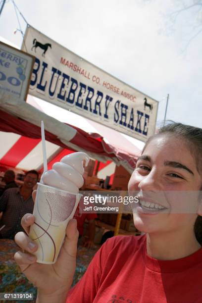 A teen girl holding a shake at the Marshall County Blueberry Festival