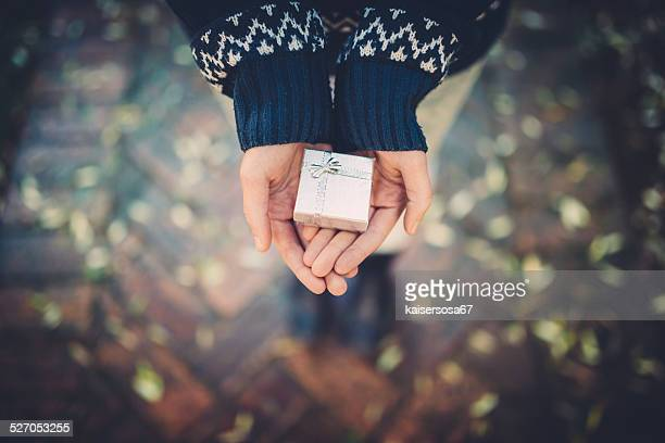 Teen girl holds a gift in her hands
