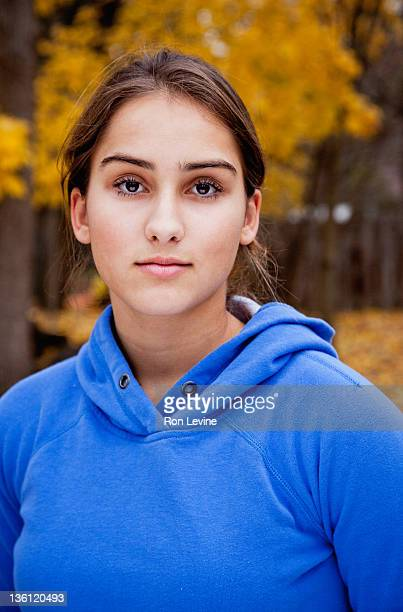 Teen girl in sweatshirt hoodie, portrait