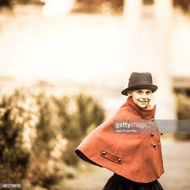 Teen girl in the hat and red coat dance