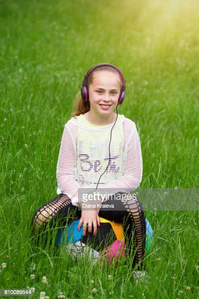 Teen girl look enjoy to listening music.