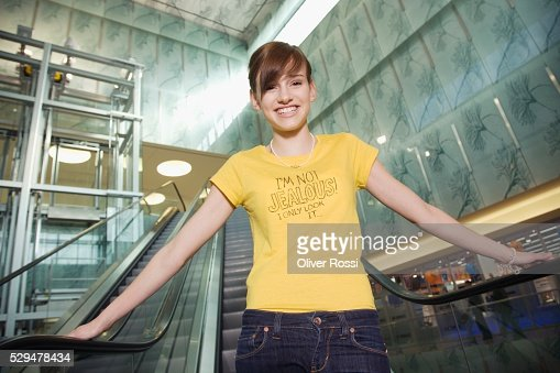 Teen girl on escalator : Foto de stock