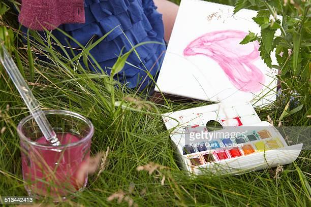 Teen girl painting watercolor heart shape