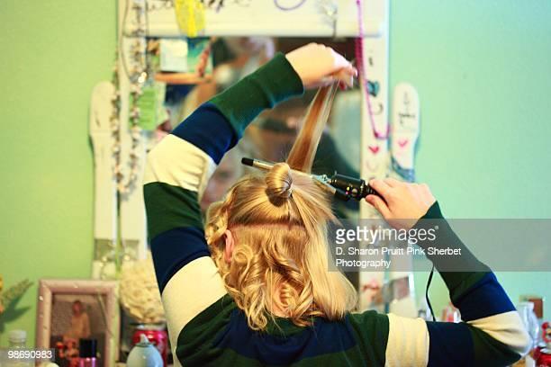 Teen Girl Primping and Preening Hair