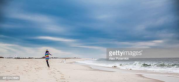 Teen girl run at the Jones Beach