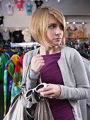 Teen girl shoplifting sunglasses