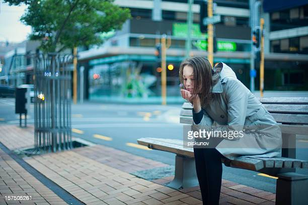 Teen girl sitting on bench