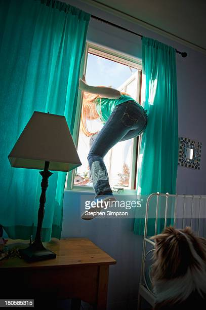 teen girl sneaking out her bedroom window