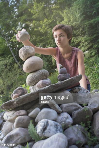 Teen Girl Stacking a Stone
