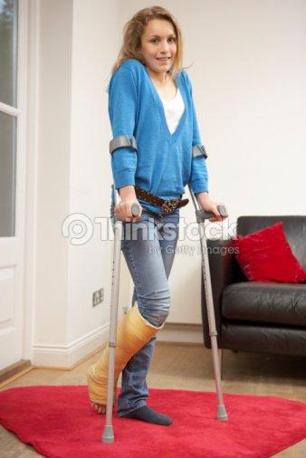 Teen Girl Using Forearm Crutches Stock Photo Thinkstock