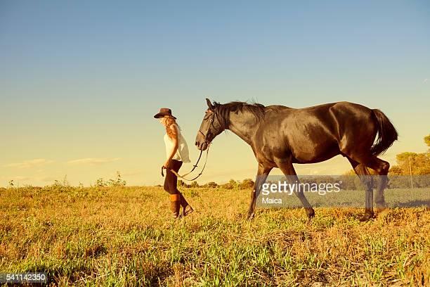 Teen girl walking her horse
