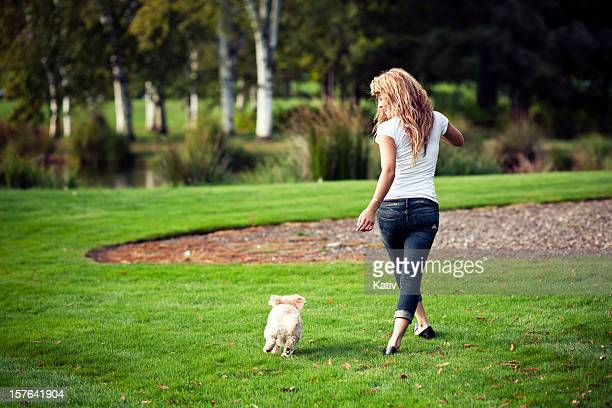 Teen Girl Walking with a Poodle