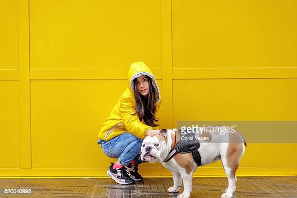teen girl walking with  DOG