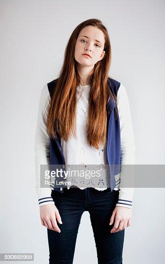 Teen girl wearing baseball jacket, portrait