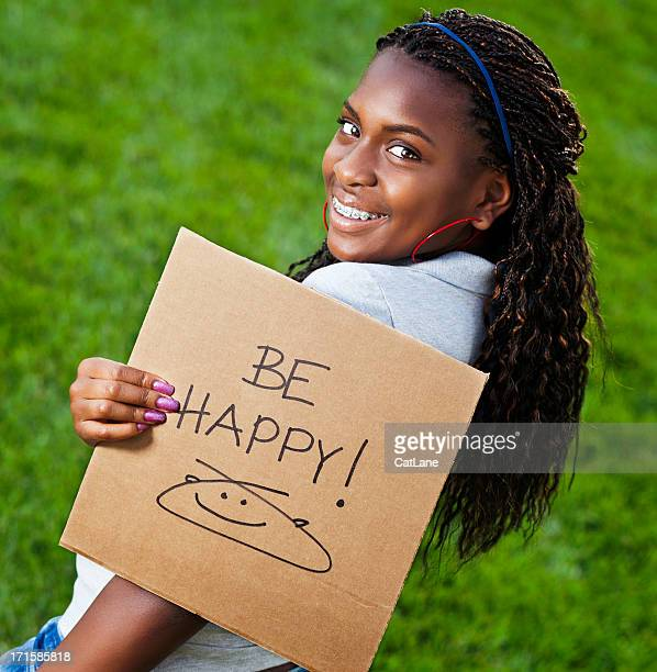 Teen Girl with Be Happy Sign
