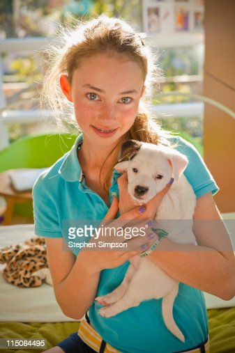 teen girl with her Jack Russell terrier puppy