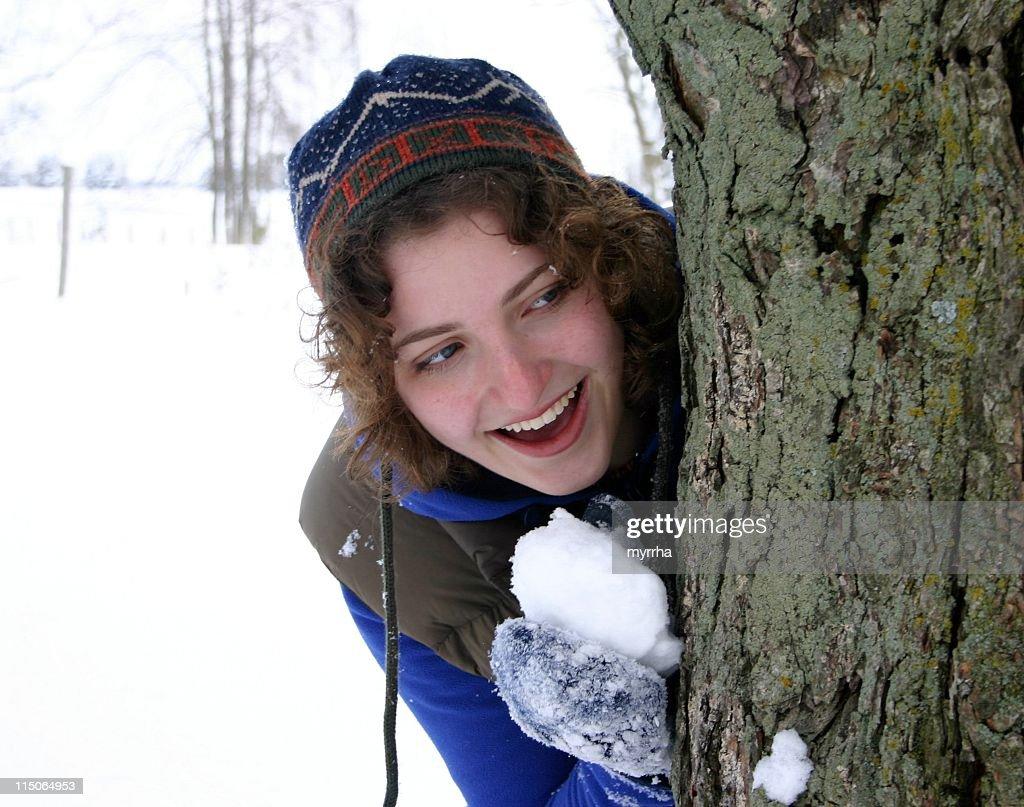 teen girl with snowball, hiding