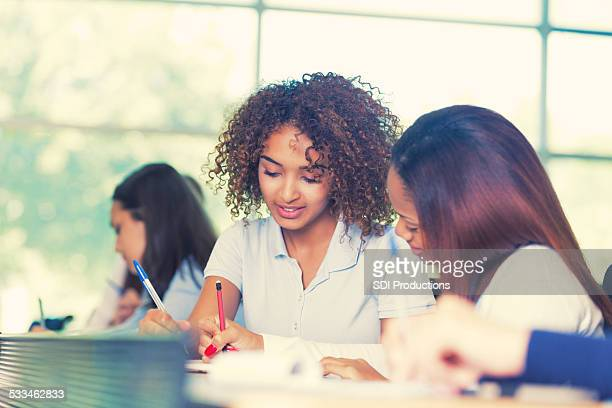 Teen girls in private school working on group assignment