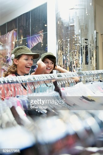 Teen girls trying on caps : Photo