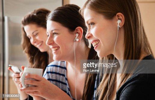 Teen Girls wearing earbuds, profiles : Stock Photo