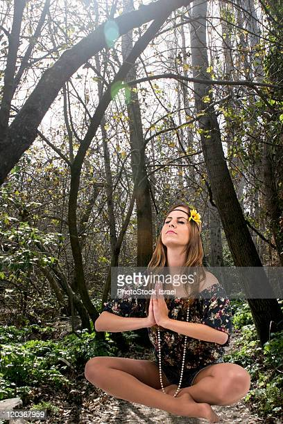 Teen Hippie girl meditates