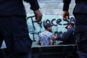 A teen in a neighborhood with heavy gang violence is briefly searched by police on July 20 2012 in Tegucigalpa Honduras Honduras now has the highest...